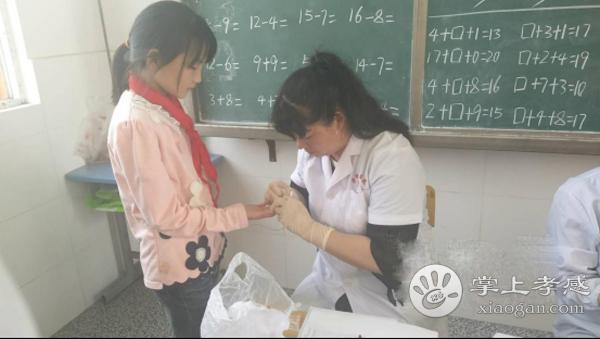 安陆孛畈镇卫生院为贫困学生免费体检[图1]