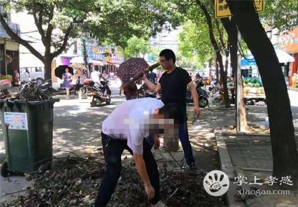 孝感勝利社區工作人員高溫清理路邊樹枝落葉[圖2]